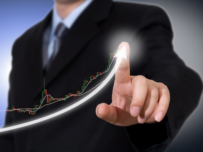 Businessman Touching A Graph Indicating Growth Picture Id973778602